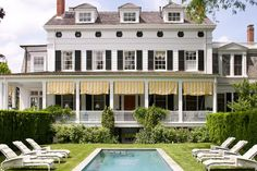 greek revival with wonderful porch. I don't care for the yellow and white fabric but the porch is pretty.