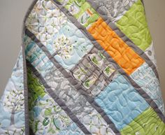 Love the Gray sashing with the great colorways. Fabric -Backyard Baby by Patty Sloniger for Michael Miller.