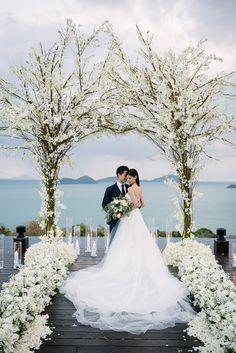 Beach oceanside wedding ceremony decor