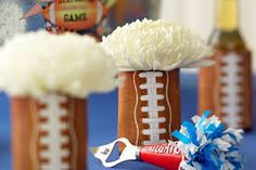 Cute little centerpieces using Football cups and fresh flowers.