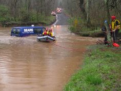 Fairfax, Va., Aug. 12, 2010 -- This swift water rescue team helps people stranded in a vehicle due to flooding.