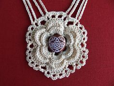 Crochet necklace with covered button center
