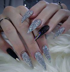 Fierce custom long black and silver glitter stiletto nails