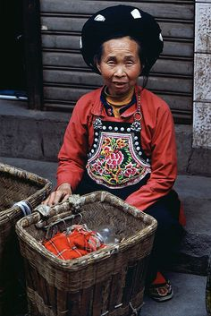 CHINA - A colorful YI woman by © BoazImages, via Flickr