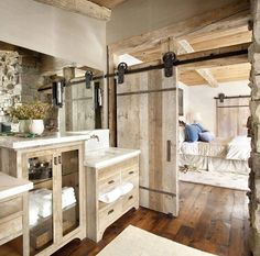 Love the dark floors and whitewash barn doors and furniture.