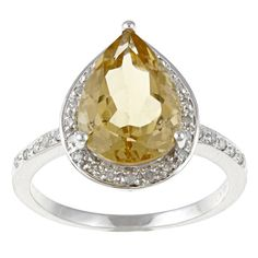 <li>Citrine and diamond ring</li><li>10-karat white gold jewelry</li><li> <a href='http://www.overstock.com/downloads/pdf/2010_RingSizing.pdf'><span class='links'>Click here for ring sizing guide</span></a></li>