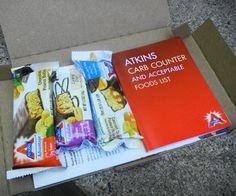 Quick Start Guide, Sample Menus, Carb Counter, 3 full-size Atkins Bars, Coupons, Recipes, Atkins App.