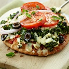 Savory spinach, feta cheese, and tomatoes make the perfect light and healthy vegetarian personal pizza ready in just 25 minutes.