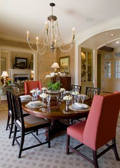 dining room, wood chairs, host chiars, chandelier, arched opening, area rug Designed by Pulliam Morris Interiors