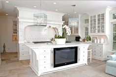 Traditional Kitchen with Crown molding, can lights, Custom hood, Undermount sink, Inset cabinets, Kitchen island, Casement
