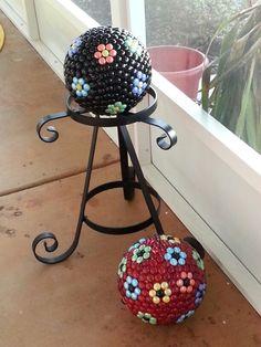 Daisy bowling ball yard art                                                                                                                                                      More
