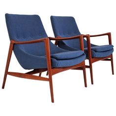 Pair of Ib Kofod-Larsen Lounge Chairs  | From a unique collection of antique and modern lounge chairs at http://www.1stdibs.com/furniture/seating/lounge-chairs/