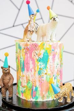 Check out the colorful birthday cake topped with animals in party hats at this party animal birthday party! See more party ideas and share yours at CatchMyParty.com