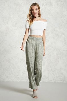 Style Deals - A pair of woven palazzo pants featuring an allover floral print and a smocked waist.