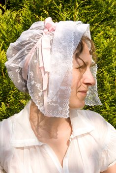 """A regency cap made of a hand embroidered cotton tulle trimmed with silk ribbon and inspired with several fashion plates from """"Costume Parisien"""" (""""Journal des dames et des modes""""), an 7 (1799) and an 8 (1800)"""