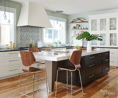 Hardwood floors have kept kitchens warm and cozy for years, and that won't change anytime soon. The material adapts to any style and flawlessly unites rooms in an open floor plan. Don't count out other flooring materials just yet, though. Porcelain planks that look like wood provide the same inviting style but are easier to maintain./
