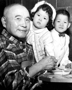 "On April 17, 1961, the elder citizens (issei) of the Japanese-American community were honored by their children (nisei) at a banquet at the A-Ri-Rang Club. Here, honored guest Joe Okuda, 67, dines with 3-year-old Pamela and 4-year-old Terry, the children of Harry Watanabe, another of the honored guests. Said Robert Nakadoi, chairman of the Omaha chapter of the Japanese-American Citizens League: ""We do not forget their effort or what they have done."" THE WORLD-HERALD"
