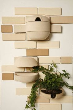 FLORA  FAUNA BRICKS  Brick Habitats is a modular building system for flora and fauna. Built into the exterior surface of a home, the bricks come in three basic shapes which can be used in various combinations to meet different needs.    The bricks can be configured into planters complete with drainage or bird feeders and houses. Imagine a wall full of growing vines or positioned near a window—a built-in herb garden could be close at hand.