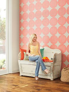 Polka dot wall using spray painted doilies