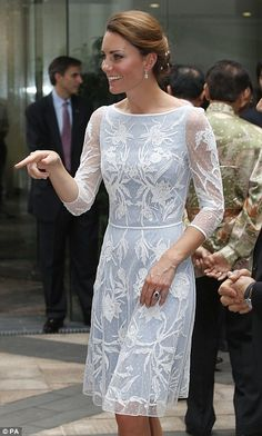 Kate, wearing an ice blue lace dress by Alice Temperley