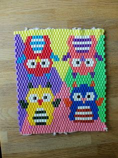 Hama beads coaster with colourful owls by cuddly angel, via Flickr