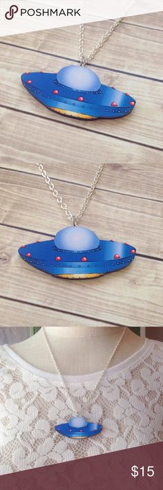 """UFO Flying Saucer Necklace This adorable UFO necklace is made from laser cut wood. The colors are very vibrant! Necklace chain is 20"""". If you prefer a different length let me know and I'll adjust it for you. Nickel & lead free. Handmade by me & brand new! I also have this available as a brooch! Bundle & save 15% on 3+ items. Tags: alien,aliens,Scifi,nerd,kawaii,geek,kitsch,spaceship Abbie's Anchor Jewelry Necklaces"""