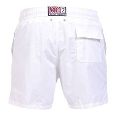 WHITE OWNER SWIM SHORTS WITH EMBROIDERY WRITING Solid white OWNER long Swim Shorts. Saint Barth LA COTONE DU VENT MC2 embroidery on front at lateral side. Two side pockets. Back Velcro flap pocket. MC2 label on waist to the reverse. Elastic waistband with adjustable drawstring. Internal net. COMPOSITION: 100% NYLON. Model wears size M, he is 189 cm tall and weighs 86 Kg.