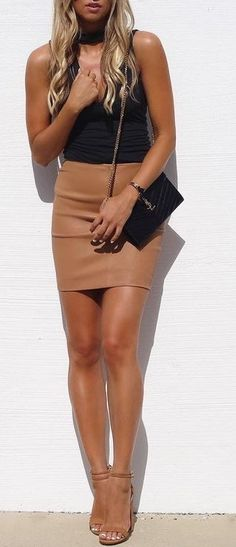 Black Top + Camel Leather Skirt                                                                             Source