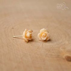 This dainty pair of rose flower studs are a beautiful shade of creamy ivory. They are made with acrylic flowers and hypoallergenic posts. They come with plastic comfort backs.