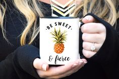 This pineapple mug makes the perfect gift for your mom, sister, coworker, or best friend! Be like a Pineapple Sweet and Fierce! More information - Choose from two color options and two sizes - Design printed on both sides - Top rack dishwasher and microwave safe - Production time is 3-5 business days. Shipping takes an additional 1-3 business days - All mugs are gift-wrapped with tissue paper, a kraft box, and a bow. If you would like a hand lettered note as well, please put your message…