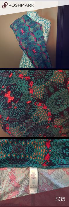 LuLaRoe TC Teal Print Leggings 💕 LuLaRoe TC Teal Print Leggings 💕 Worn & washed once per LLR standard. Can no longer wear TC. Dark purple background. Mostly teal, pops of melons and fuchsia. Super FUN Print!!! *CROSS POSTED* LuLaRoe Pants Leggings