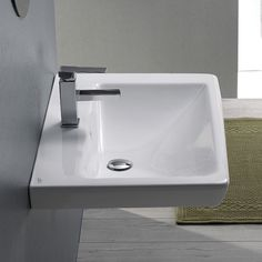 22 inch wall mounted or drop-in bathroom sink with one faucet hole and an overflow. Sink is made of high-quality white ceramic. This modern sink is made and designed by Turkish brand CeraStyle Drop In Bathroom Sinks, Drop In Sink, White Bathroom Tiles, Bathroom Ideas, Bungalow Bathroom, Chrome Towel Bar, Space Saving Bathroom, Modern Sink, Wall Mounted Bathroom Sinks