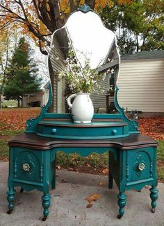 Gorgeous distressed vanity, love that mirror shape.