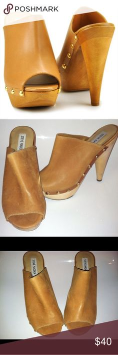 Steve Madden clogs Steve Madden wooden clogs size 7.5 in good condition. The 2nd-4th pictures are the actual shoes Steve Madden Shoes Mules & Clogs