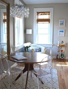 Eclectic Dining Room by Megan Blake Design Modern table with Louis Ghost chairs. Perfect for small spaces but appropriate anywhere, clear chairs like the . Acrylic Dining Chairs, Acrylic Chair, Acrylic Furniture, Small Room Design, Dining Room Design, Small Dining, Round Dining Table, Dining Area, Round Tables