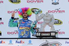 "Jimmie Johnson, driver of the No. 48 Lowe's/Madagascar 3 Chevrolet ""wigs out"" in Victory Lane after clinching his seventh career victory at Dover International Speedway."
