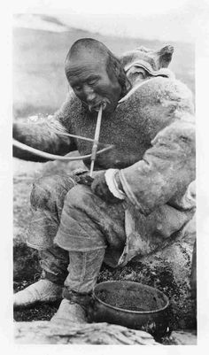 Inuk man using bow drill on a bone. We Are The World, People Of The World, Inuit People, Tlingit, Inuit Art, Native American History, Prehistory, Native Indian, Aboriginal Art