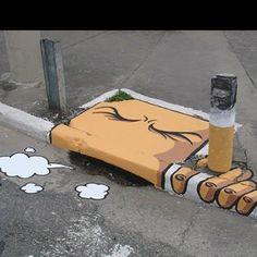 Deze kunstenaar laten zien dat roken slecht voor je is en dat je mond er van gaat stinken.