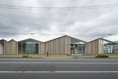 Towada City Plaza Aomori, Japan 2015.01 plaza for social communication 1,800 m2 This wooden building was constructed as the city's community center for people to gather. We repeated the roofs for the façade so that it could merge into the neighboring townscape of small houses. On the exterior wall, wainscot panels are applied with spaces in between, and it expresses a warm and friendly face to the street of the land to the north. The street in front of the building actually extends into the…