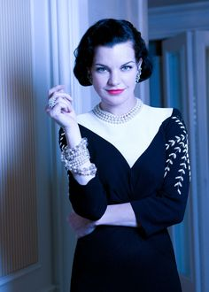 Vintage glamour Pauley Perrette stuns in playful, vintage attire. The New York Vintage dress has an exaggerated collar that balances the delicately sewn floral patterns. The NCIS actress tops off the look with Chanel earrings and a New York Vintage necklace and bracelet.