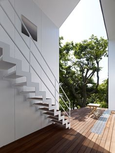 '47% house' by tokyo-based practice kochi architect's studio (kazuyasu kochi) is a two-storey  private dwelling in kamakura, japan. providing a number of generously-sized outdoor programs,  the interior floor area equals 47% of the total building footprint to result in a holistic layout that  incorporates exterior spaces into its design.