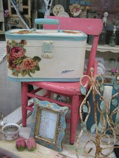 A Pink primary object accented with soft blues is a great combination for that Cottage feel as well.  Decoupage roses are also a very strong Shabby Chic accent