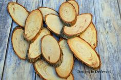 This is a set of 25 oval rustic slices. These very rustic oval slices are natural with no finish. These slices are approx 4 x 2 inches. Would