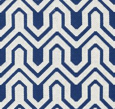 Montserrat Fabric An upholstery fabric in an epingle weave with a interlocking geometric pattern in blue and white.