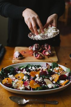 Winter Salad by Babes in Boyland:  100 g black cabbage Baby spinach 100 g red cabbage 1 red onion 1 apple 1 orange 1 beetroot 1 pomegranate Feta cheese  For serving Pumkin seeds Balsamic vinegar Olive oil Salt and pepper