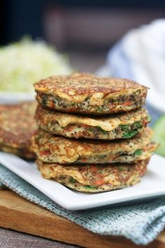 Cauliflower Fritters   •Half a large head cauliflower  •1 carrot, grated  •2 whole eggs  •¼ cup flaxseed meal  •¼ cup raw, unsalted sunflower seeds  •¼ cup hazelnuts, finely chopped  •¼ cup fresh parsley, finely chopped  •1 tsp lime juice  •1 tbsp poppy seeds  •¼ tsp black pepper  •1 tsp fresh thyme  •½ tsp ground cinnamon  •¼ tsp smoked paprika