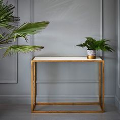 Our stylish new Odell Gold And Marble Console showcases a gold leafed finish and smooth marble top. Perfect for bringing a touch of luxury to a dining room or hallway, this table embodies this season's metallic and marble trend. Cafe Design, Drawing Room, Living Room Inspiration, Marble Top, Game Room, New Homes, Graham, Dressing Tables, Interior