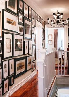 this hallway is fabulous - from the gallery wall to the light fixture - love.