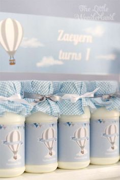 Milk bottles at a hot air balloon birthday party! See more party planning ideas at CatchMyParty.com!