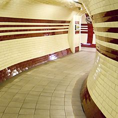 london underground tiles - I always loved the round tunnels and the sleek lines of the tube stations pedestrian passages...